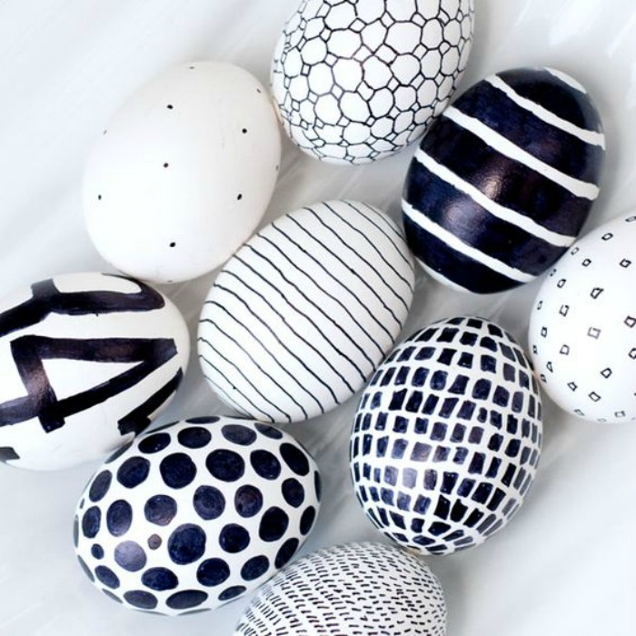 Decorate Easter eggs by coloring with a Sharpie marker