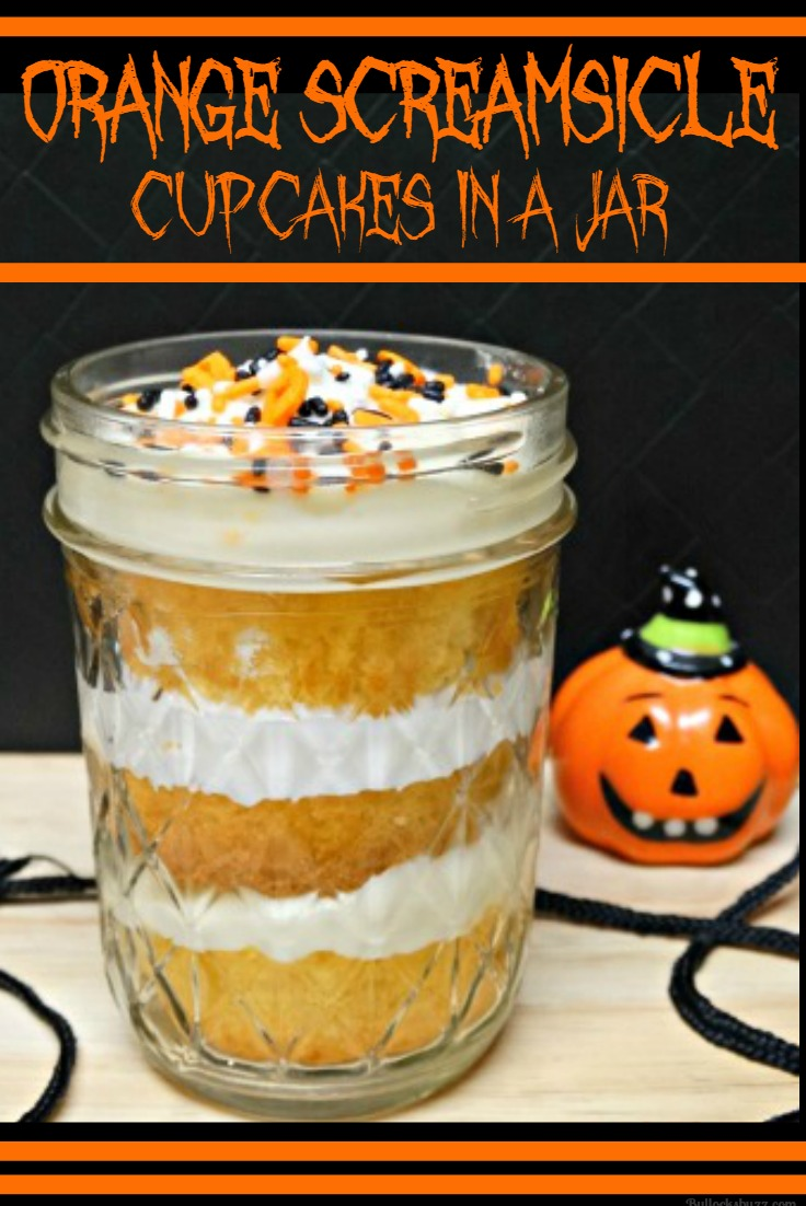 Halloween Treats A hauntingly delicious Orange [S]creamsicle cupcake with orange cream cheese icing placed in a jar.