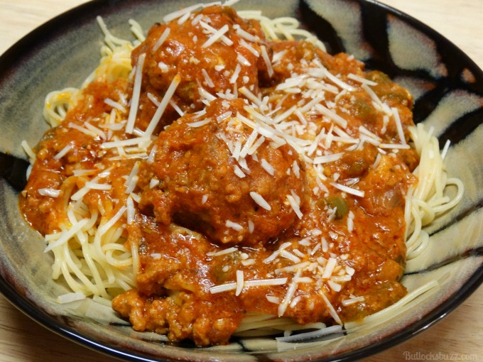 Spaghetti and Meatballs with Fresh Garden Vegetables and grated parmesan
