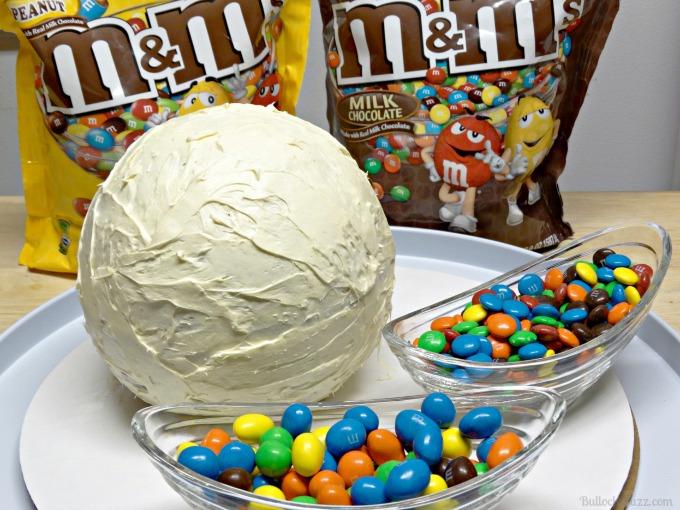 M&M Beach Ball Cake add frosting