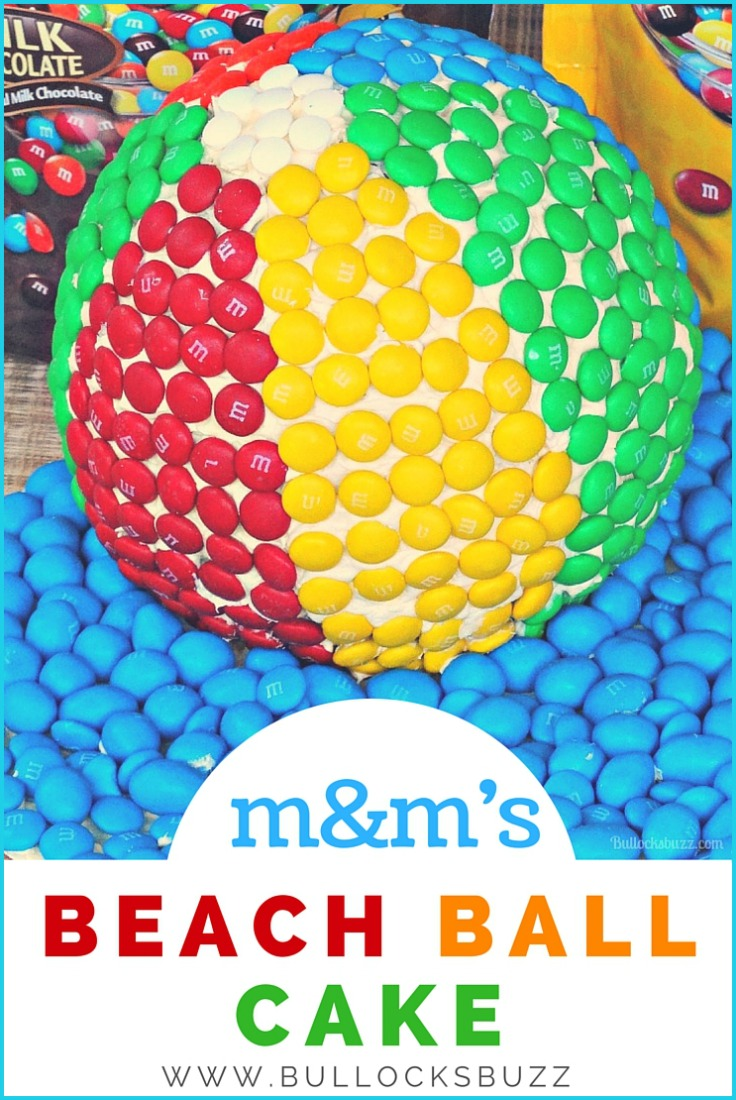 m&m's beach ball cake. A fun cake perfect for beach themed parties! Vanilla cake is iced in vanilla icing then covered in m&m's!