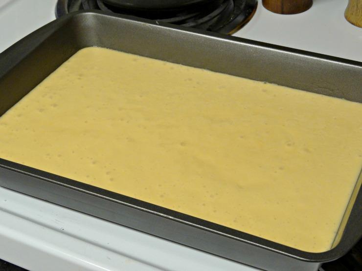 Halloween Haunted Graveyard Fanta Orange Cake with OREOs pour batter into pan