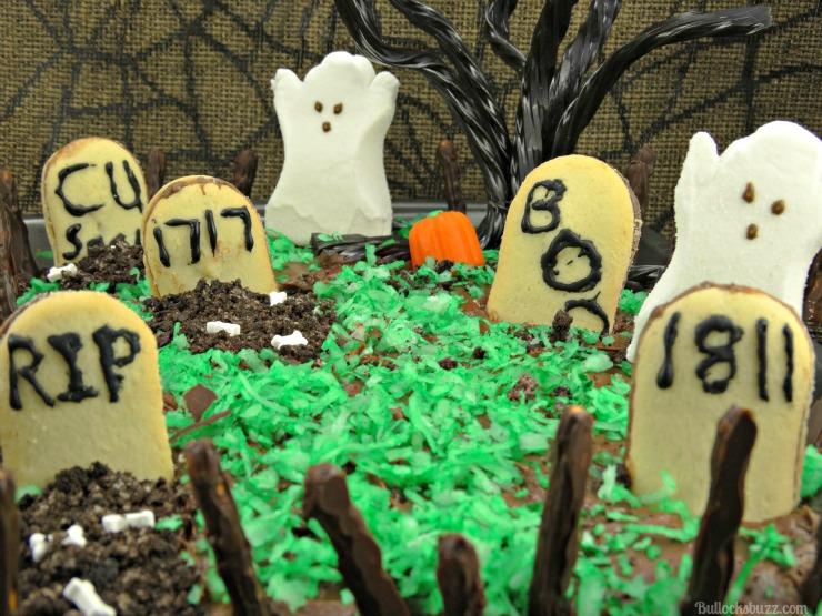 haunted graveyard fanta orange cake with oreo fence close up