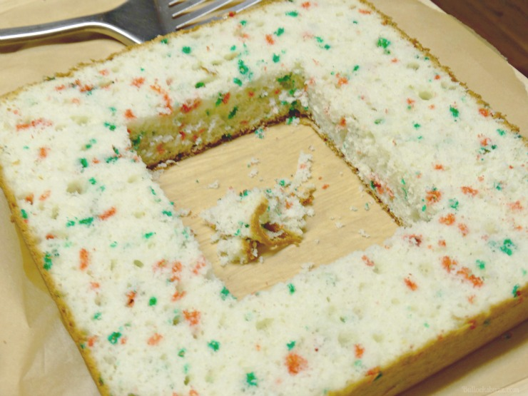 Holiday Present Pinata Cake M&M's Surprise Bake cut a square out from the middle of each of the two layers