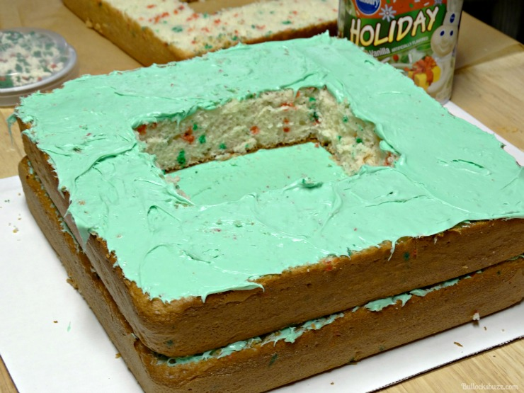 Holiday Present Pinata Cake M&M's Surprise lightly frost that layer