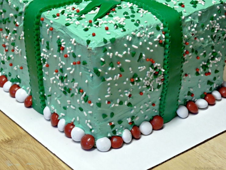 Holiday Present Pinata Cake M&M's add Peppermint M&M's around the bottom edge of the cake