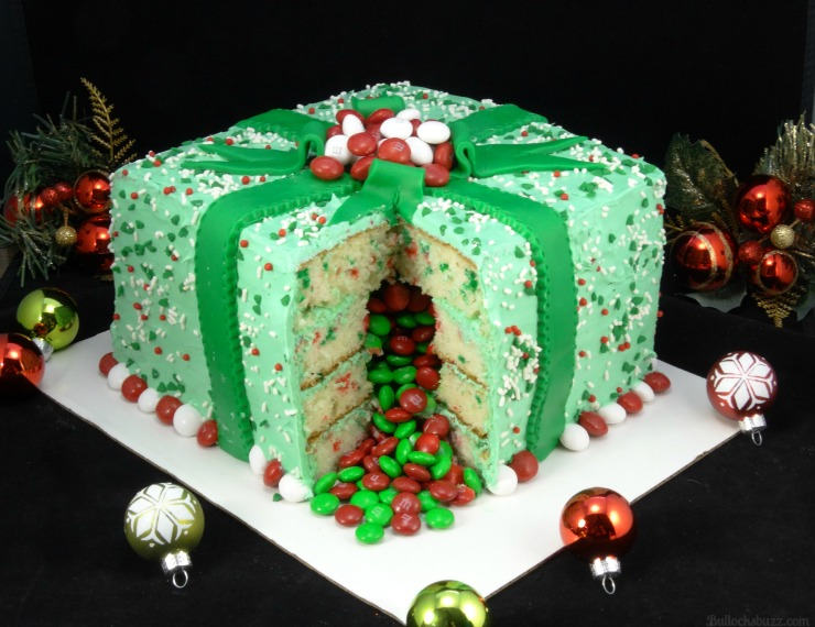 Holiday Present Pinata Cake M&M's surprise inside cut slice to see surprise inside