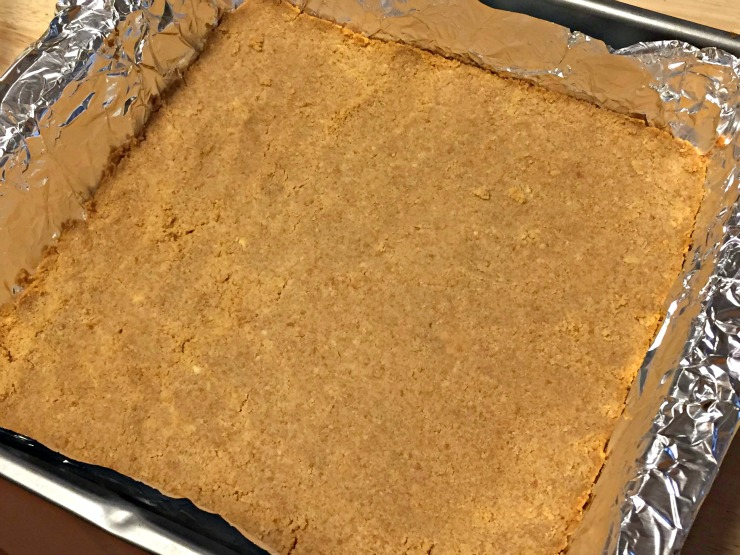 NILLA PB and Mallow squares recipe thanksgiving smooth mixture in bottom of foil lined pan