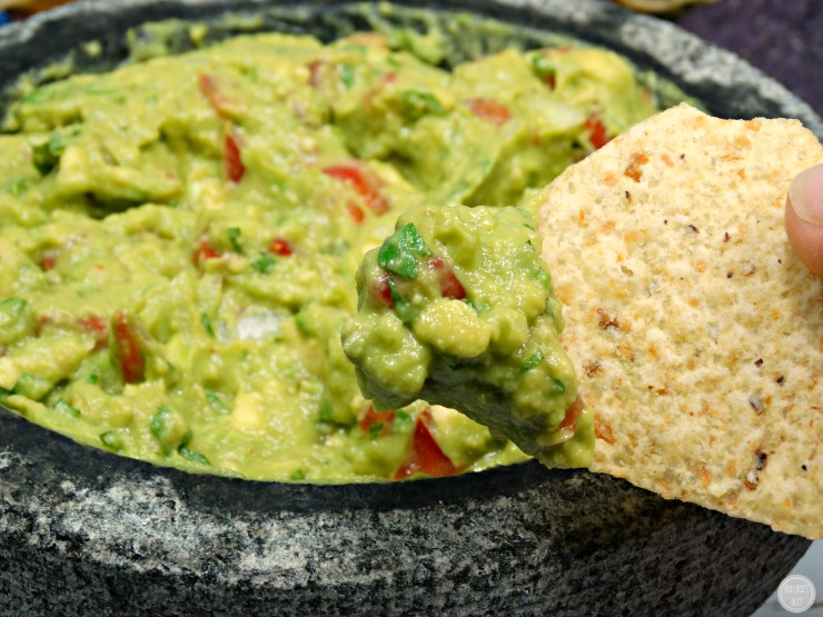 Guacamole with IMUSA Molcajete and tejolote mortar and pestle cinco de mayo on chip
