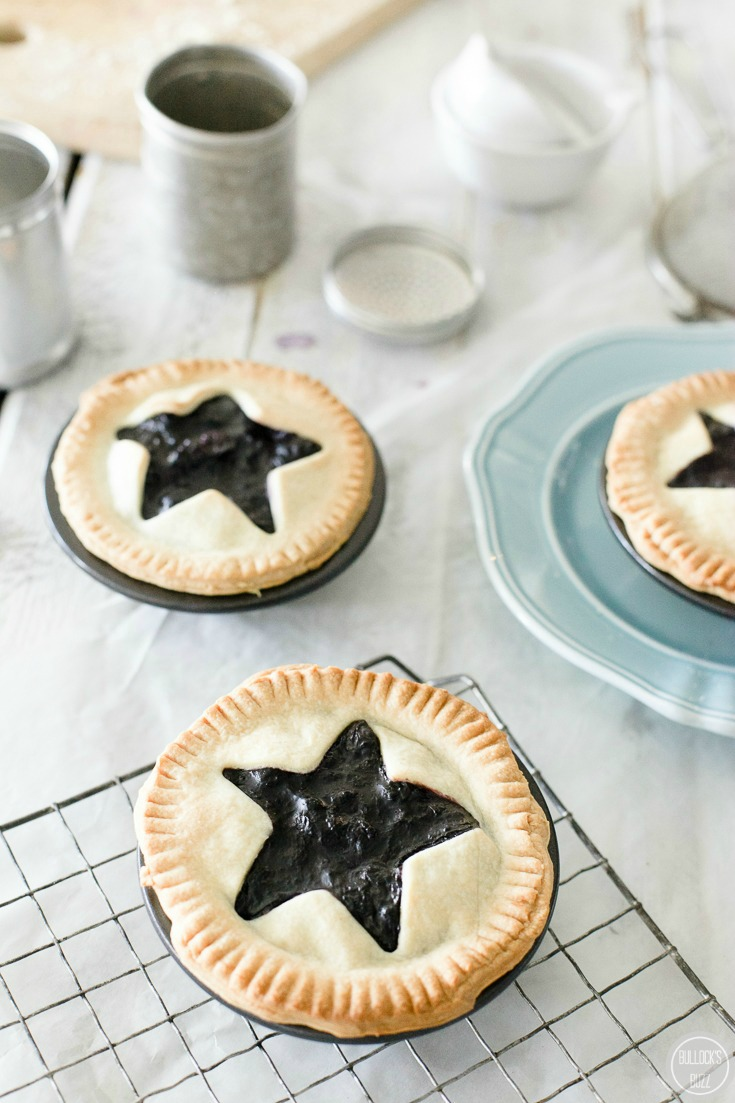 mini blueberry pies put in oven to bake
