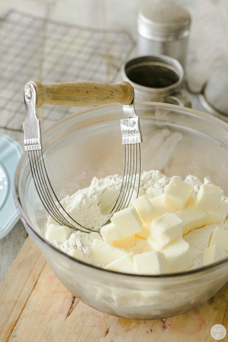 mini blueberry pies cut butter into flour