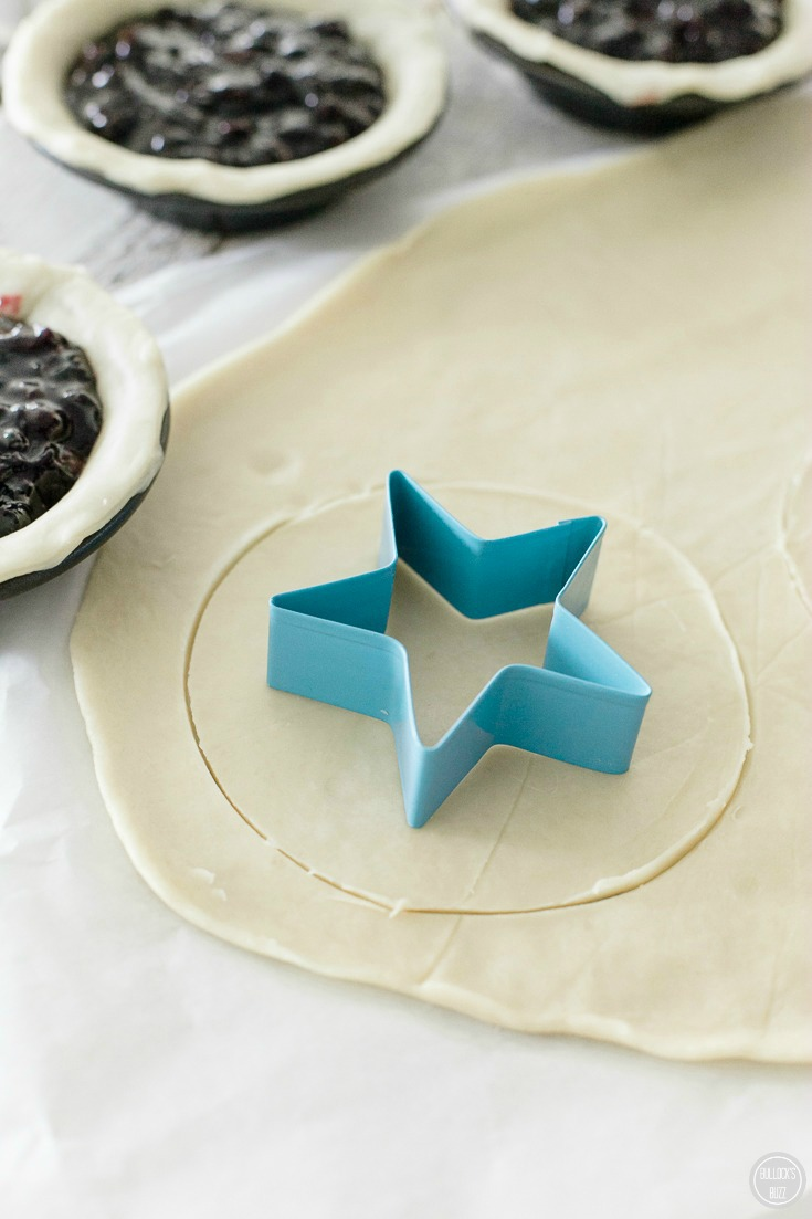 mini blueberry pies roll out another dough and use star shaped cookie cutter