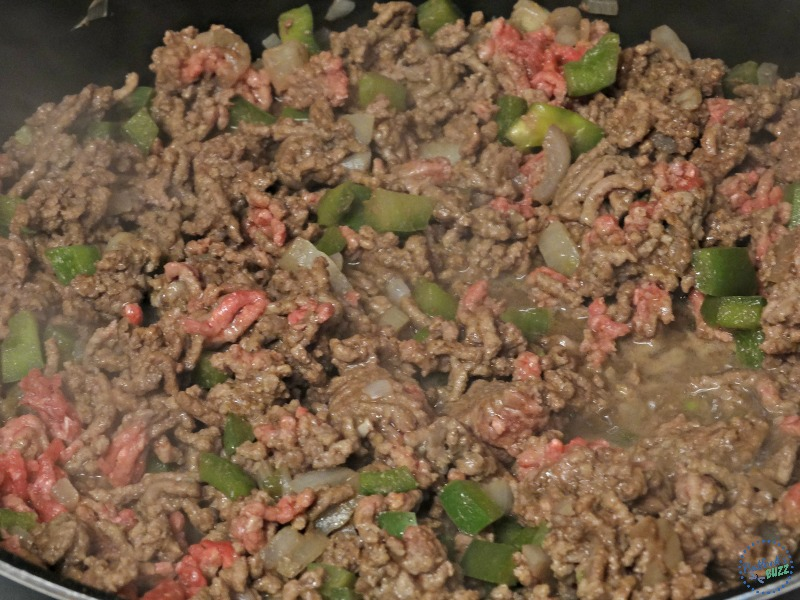 chili recipe brown meat and vegetables in skillet