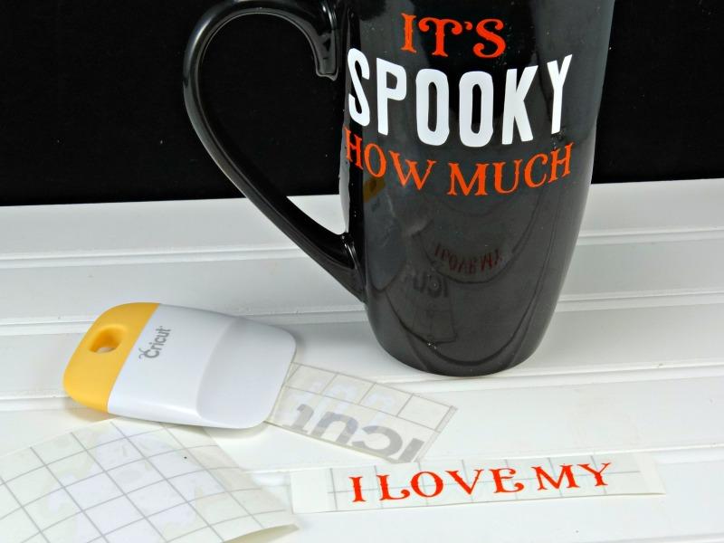 begin adding vinyl to the DIY Halloween coffee mug smoothing as you go