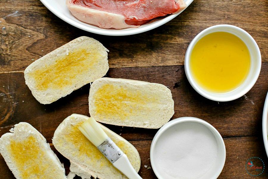 Steak and Heirloom Tomato Panzanella spread olive oil on bread