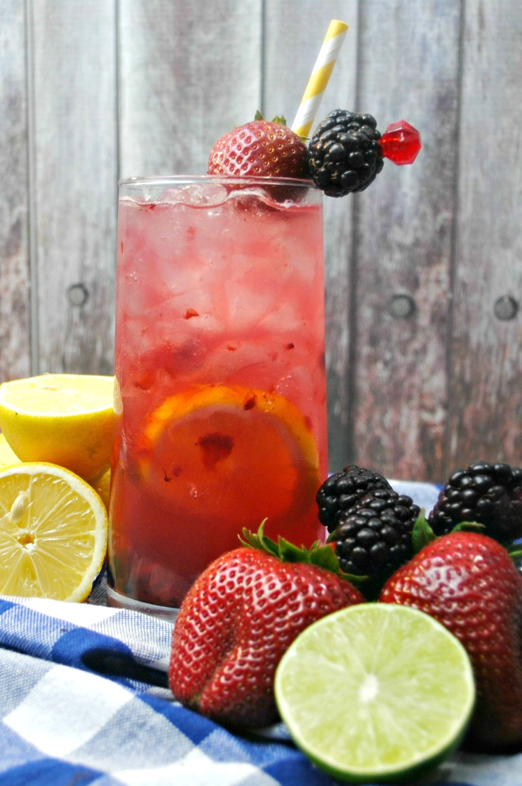 A simple, yet refreshing adult-only lemonade made with a splash of fresh squeezed lemon and lime, fresh berries and then topped off with Rum and Vodka. This Berry Smash Lemonade is a fruity concoction that's sure to be a smash hit!