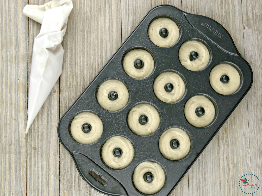 Mini Baked Donuts with Caramel Glaze fill the donut molds with batter