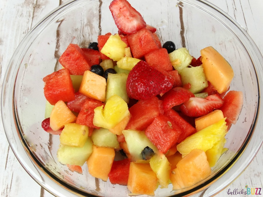 Pineapple Boat Fruit Salad toss to mix