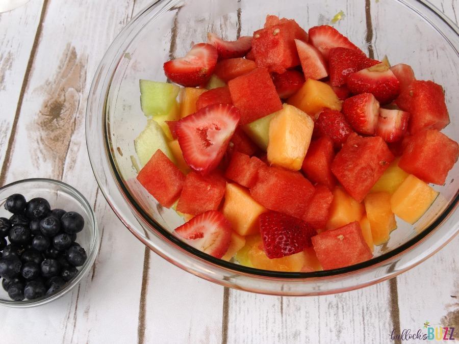 Pineapple Boat Fruit Salad add berries