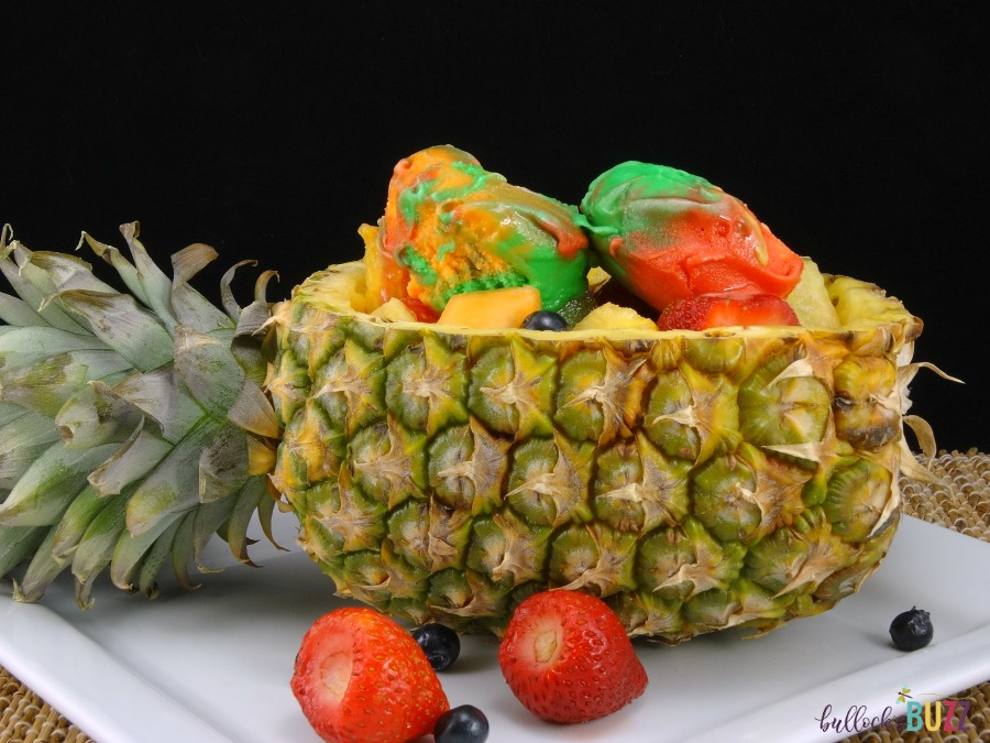 Served in a pineapple boat, fresh fruit is tossed together then topped with a few scoops of your favorite flavor sherbet in this deliciously refreshing Pineapple Boat Fruit Salad recipe.