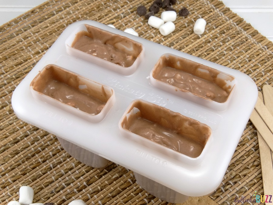 S'mores Pudding Pops fill molds three quarters full with mixture