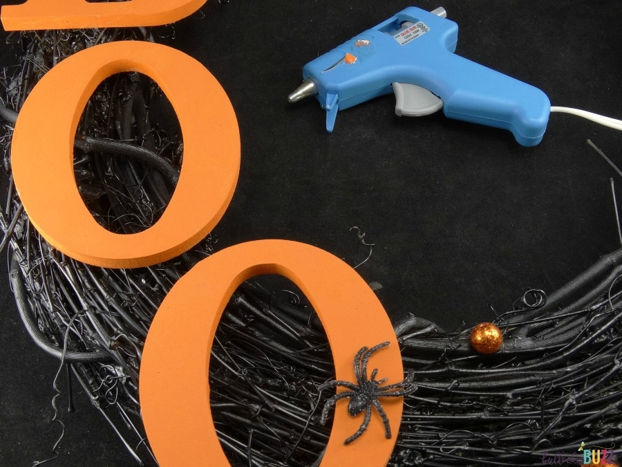 DIY Halloween Wreath tutorial use hot glue to attach letters to wreath