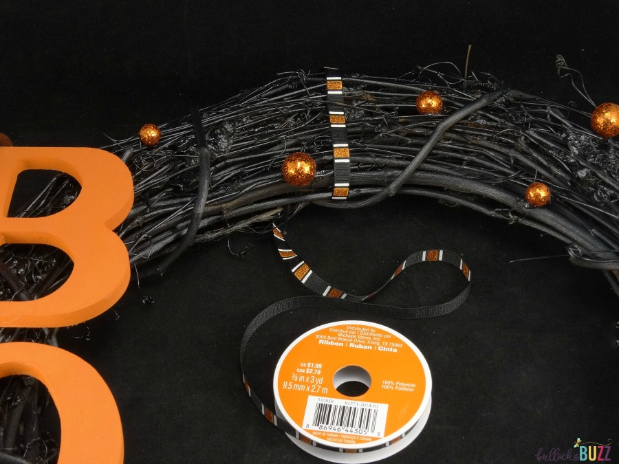 Handcrafted Halloween Wreath tutorial make a hanger from ribbon tied to top of wreath