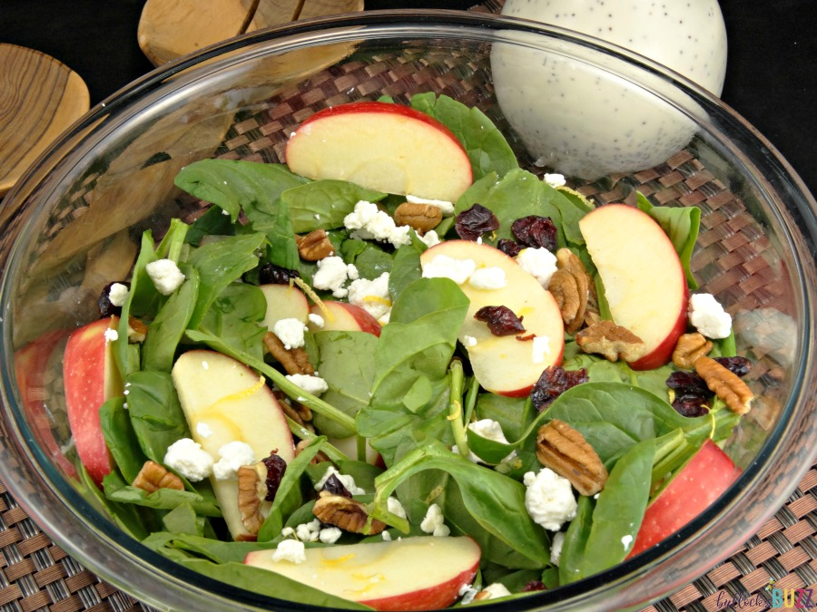 overhead shot of salad with apples, cranberries, walnuts and goat cheese