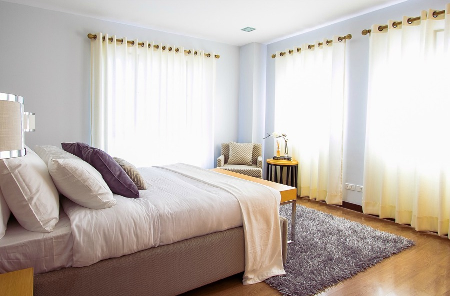 area rugs add warmth and comfort to bedrooms