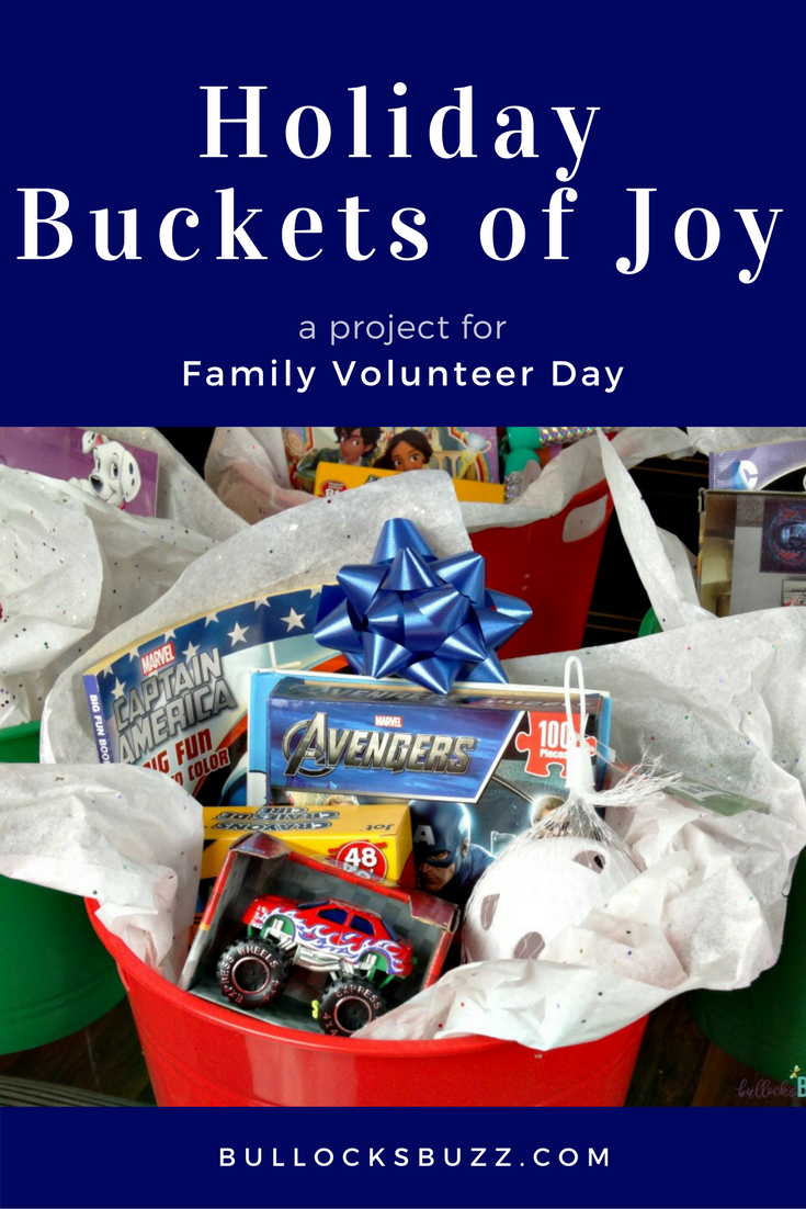These simple DIY Holiday Buckets of Joy are a fun and easy way to give back as a family on Family Volunteer Day!