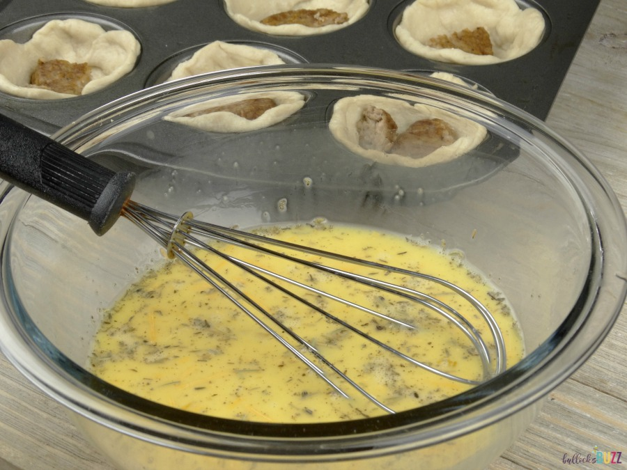 Whisk together the eggs, cheese, salt, pepper, rosemary,. sage and thyme for your Sausage, Egg and Herbed Cheese Breakfast Muffins