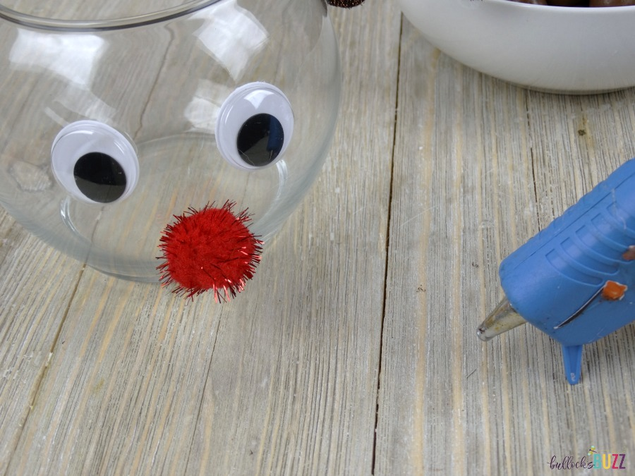 DIY Rudolph Christmas Candy Jar glue on eyes and nose