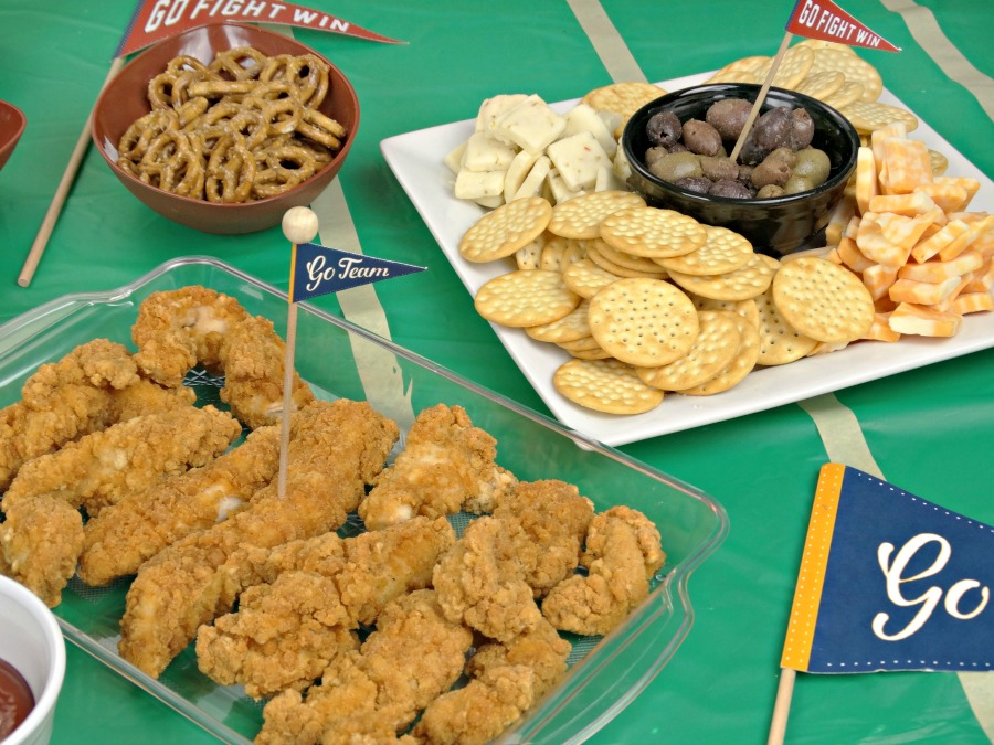 tailgating appetizers with chicken crackers and cheeses