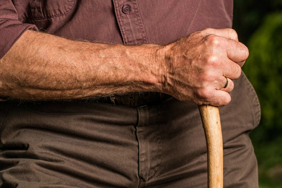 preventing falls in the elderly - man using a cane