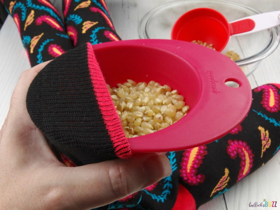 DIY Draft stopper add popcorn kernels to sock alternating with stuffer