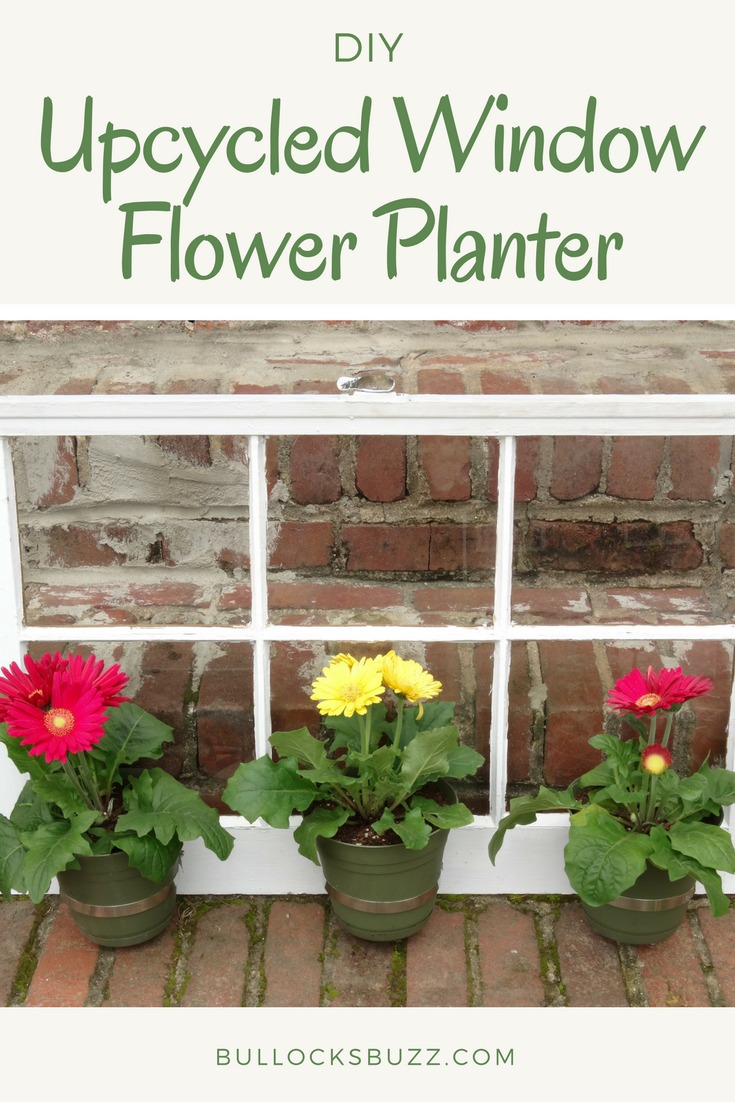 Turn an old window into a gorgeous window flower planter with this fun tutorial for a DIY Upcycled Window Flower Planter. This simple flower planter not only looks amazing, it's incredibly easy to make.