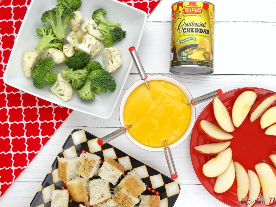 Cheddar Cheese Fondue served with apples, veggies and bread