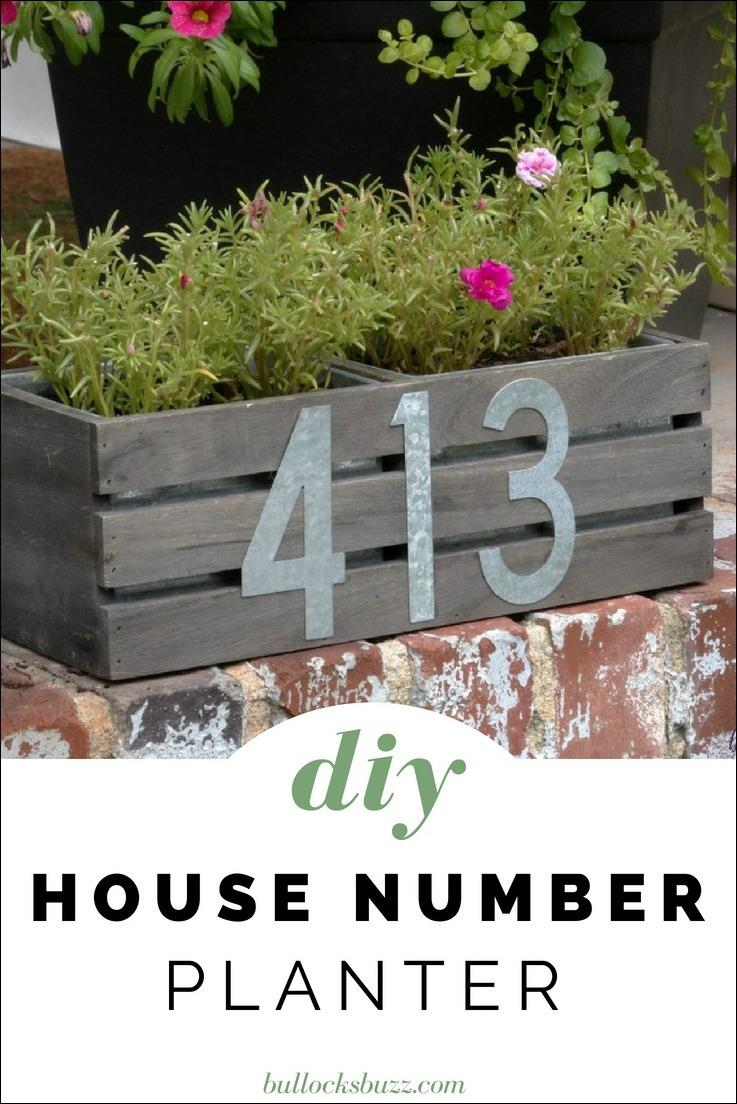 The combination of the dark wood crate with galvanized planters and matching numbers gives this DIY house number planter a slightly rustic, farmhouse look.