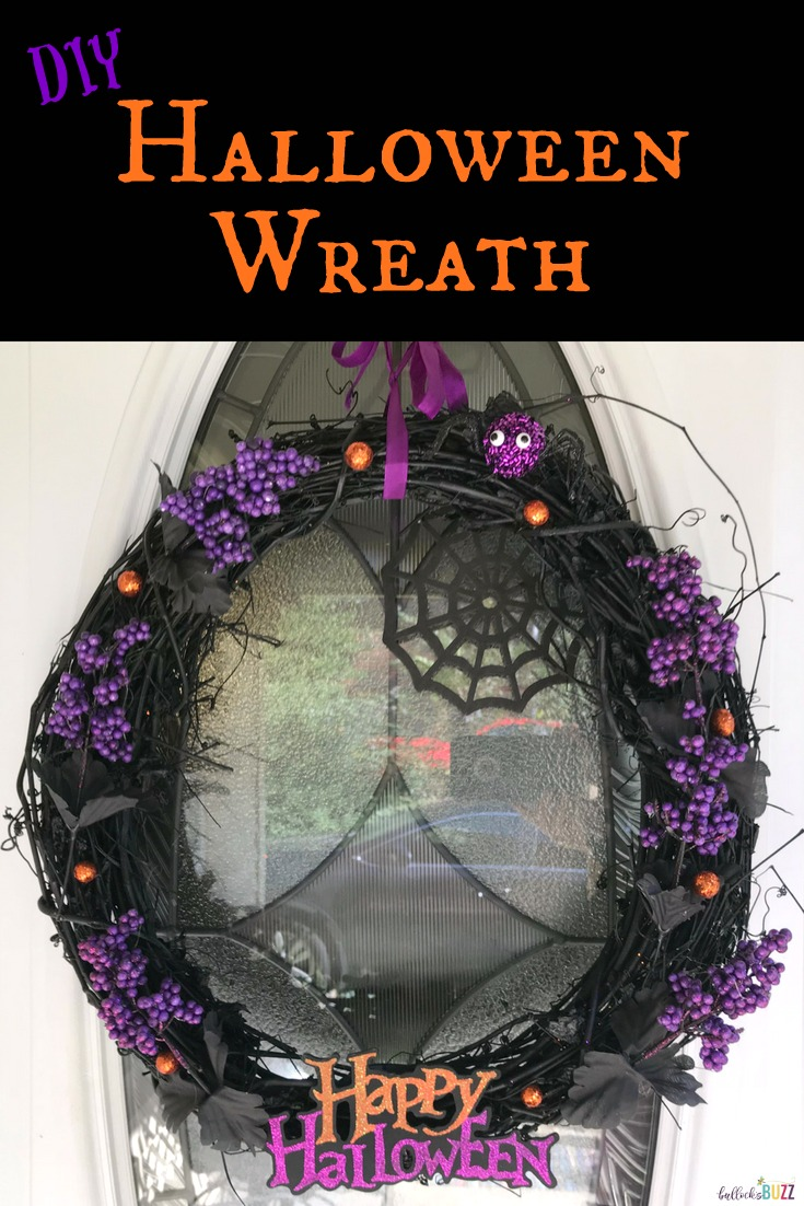 Trick out your door with this spooktacular DIY Black and Purple Halloween Wreath. Make it in a few simple steps with this tutorial. #Halloween #craft #HalloweenCraft #HalloweenWreath
