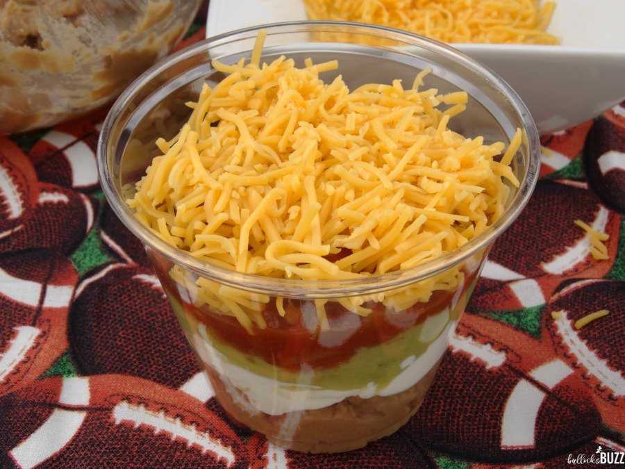 Individual Five Layer Football Party Dip Cups top salsa with cheese
