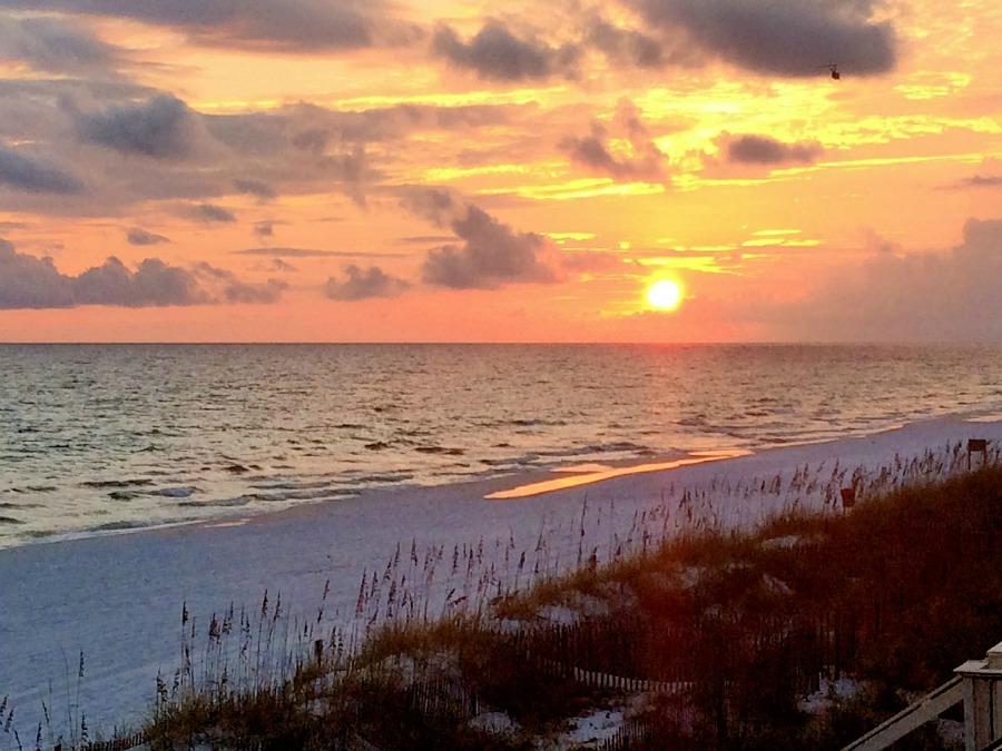 easy Money-Saving Vacation Tips beach sunset