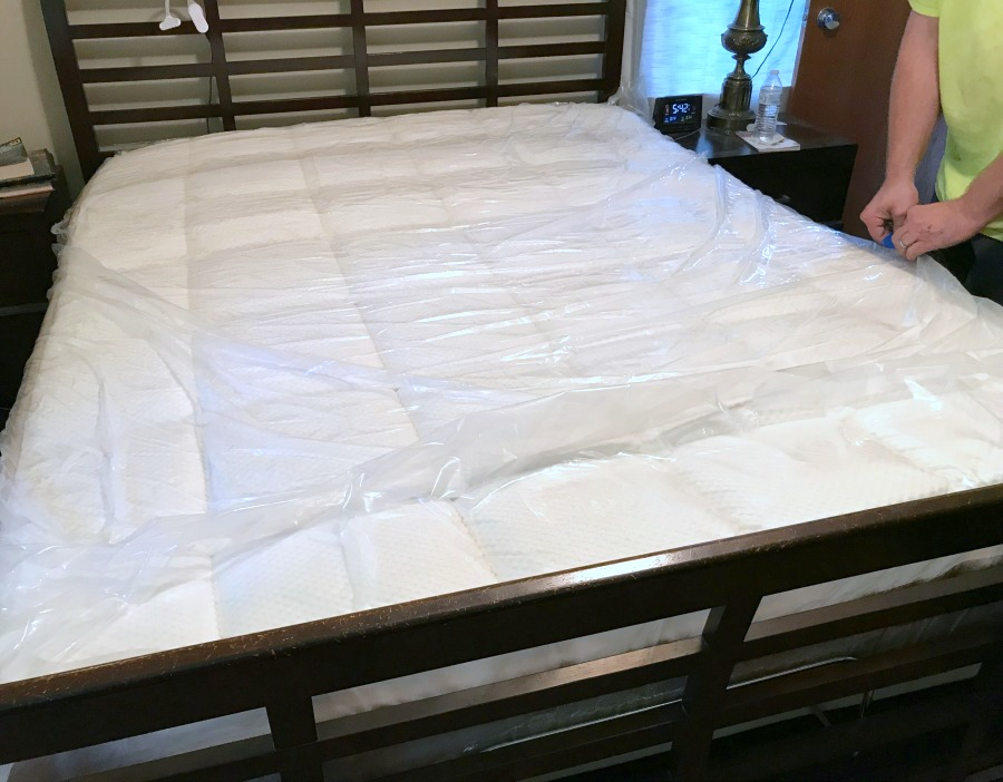 dreamcloud mattress unrolled removing plastic