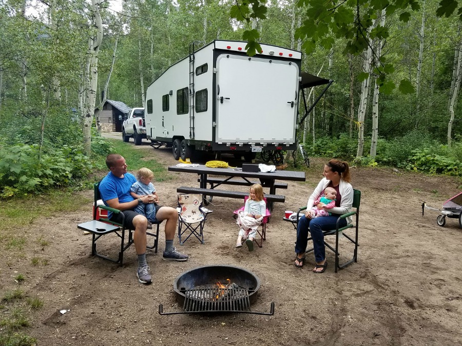 4 Outdoor Activities That Promote Family Bonding camping with family in woods