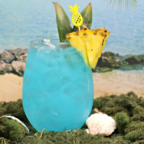 Sparkling blue, fruity summer cocktail recipe for Blue Hawaiian