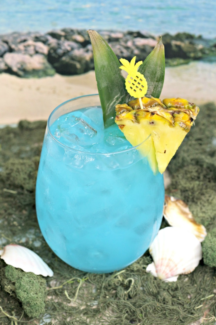 Enjoy the sunsational taste of the tropics with this fun and fruity ocean-blue summer cocktail. This Blue Hawaiian Cocktail recipe makes a delicious adult beverage that's ideal for warm-weather parties!