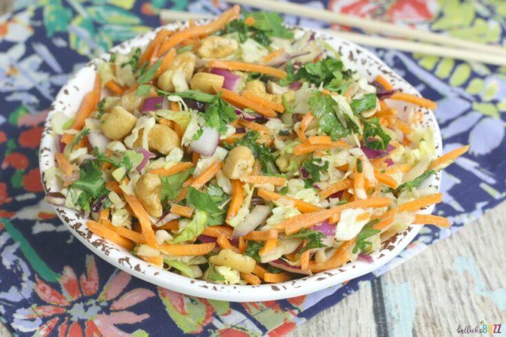 finshed thai chicken salad in bowl with chopsticks