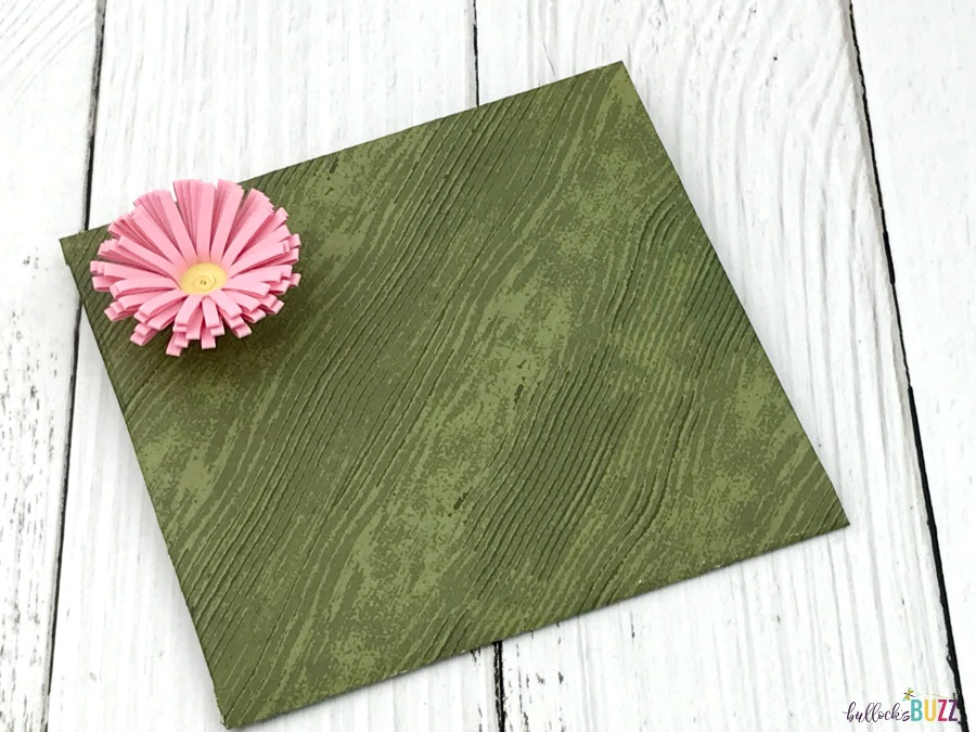 green DIY gift card envelope finished with pink flower
