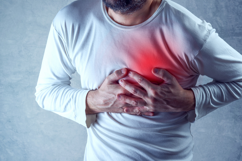 sleep can help prevent heart problems like this man grabbing his chest