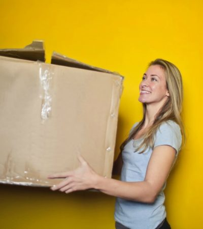 woman carrying moving box