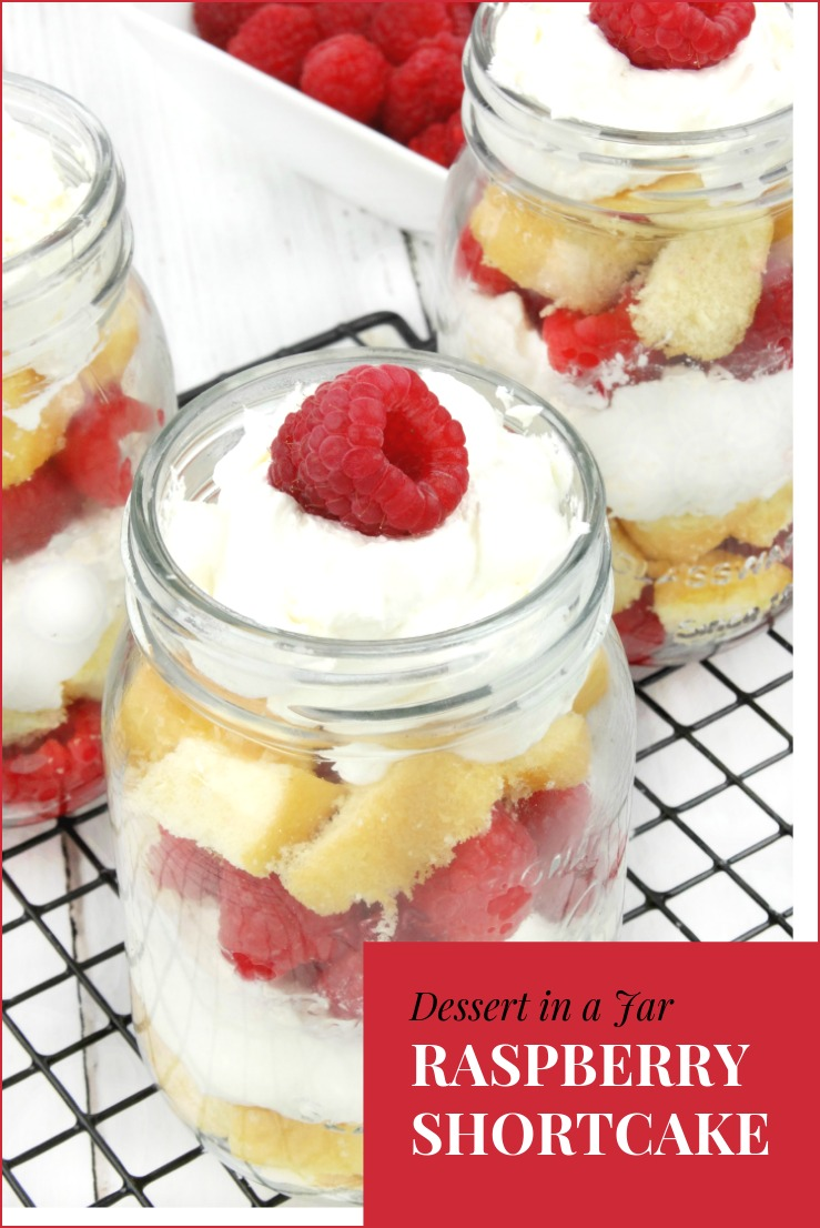 Fresh raspberries layered with clouds of rich, fluffy whipped cream and sweet vanilla pound cake makes this Raspberry Shortcake in a Jar dessert sinfully delicious! #recipe #desserts